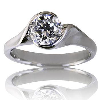 Style:ER369F ~ Simple and elegant is what best describes this engagement ring with a round brilliant cut semi-bezel set diamond.