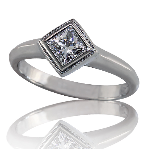 Style:ER400 ~ A brilliant princess cut diamond, bezel set catty-cornered in platinum for a unique look.