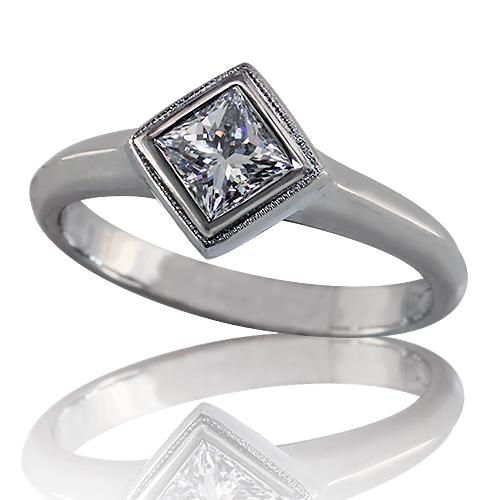 Style:ER400 ~ A brilliant princess cut diamond, bezel set catty-cornered in platinum for a unique look.