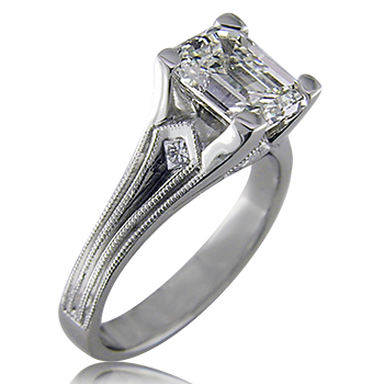 Style:ER405B ~ A touch of an art deco style sets off  this emerald cut engagement ring.