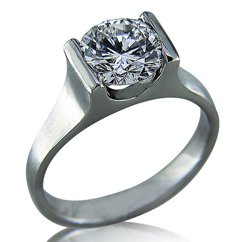 Style:ER413 ~ Simple, elegant lines set off this round brilliant diamond in a platinum engagement ring.