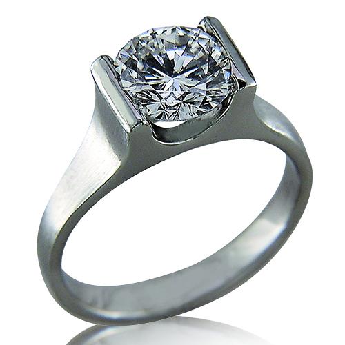 Style:ER413 ~ Simple, elegant lines set off this round brilliant diamond in a platinum engagement ring.