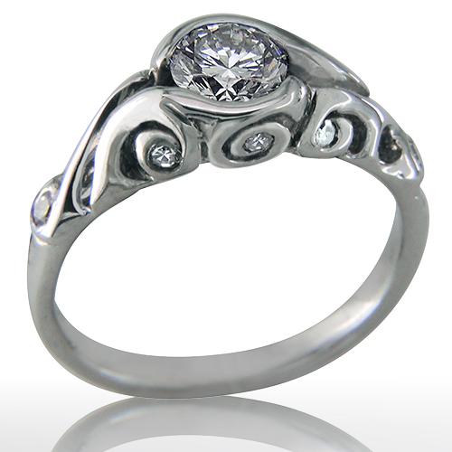 Style:ER414B ~ Diamonds bezel set in curlicues.