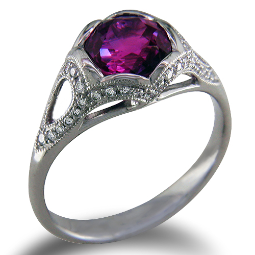 Style:ER425B ~ A stunning magenta sapphire sits in a scalloped bezel with bead set diamonds.