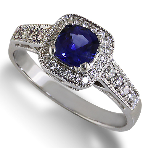 Style:ER429 ~ A cushion cut blue sapphire with a halo of diamonds.