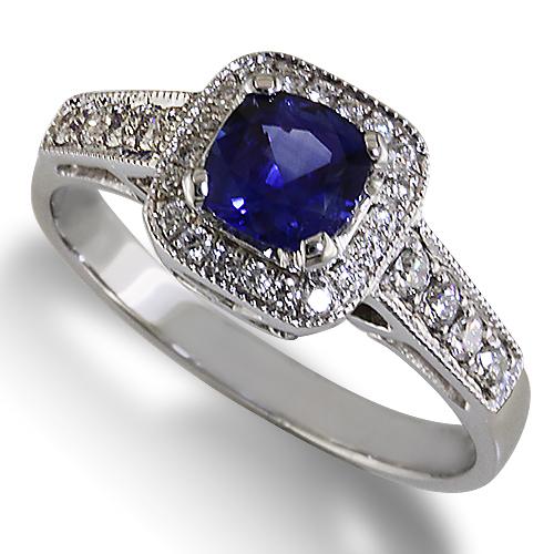 Style:ER429 ~ A cushion cut blue sapphire with a halo of diamonds.