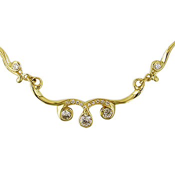 Style:F123AB ~ An 18k yellow gold and diamond necklace.