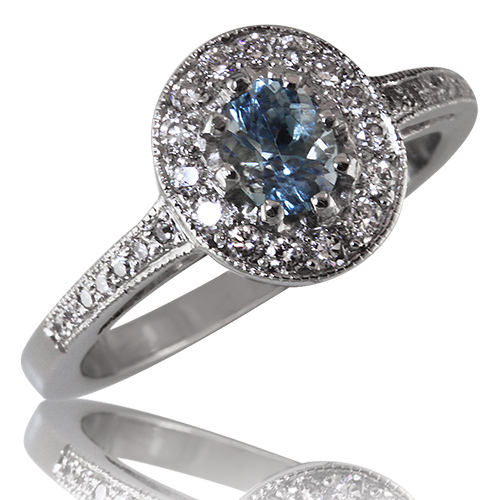Style:LRO96  An oval aquamarine surrounded by a halo of diamonds.