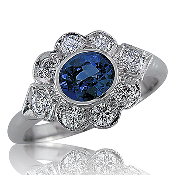 Style: LRM784R537 ~ This oval blue sapphire is set off with a pretty pattern of diamonds.