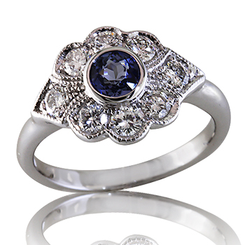 Style:LRM784.R713 ~ Diamonds set in a beautiful scallop shape setting surround a round blue sapphire.