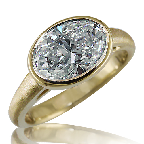 Style:LRO60B ~  A simply stated18k yellow gold engagement ring  with an oval bezel set brilliant cut diamond.