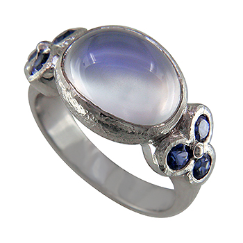 Style:LRO67A ~ A rainbow moonstone, enhanced with blue sapphires set in white gold creates a lovely ring.