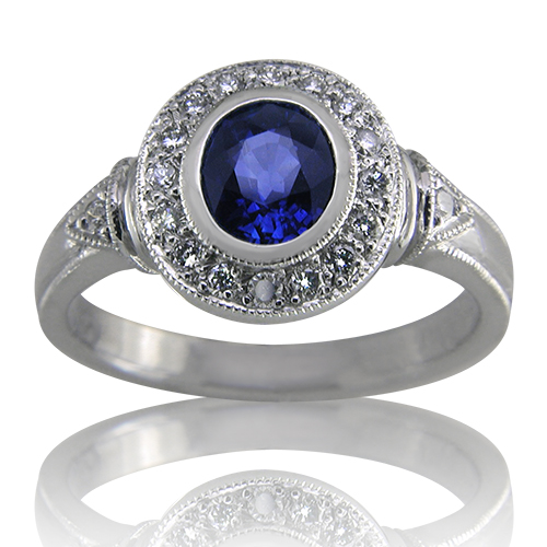 Style:LRO69B ~ A halo of diamonds surround this brilliant oval blue sapphire.