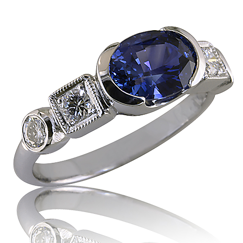 Style:LRO73B-R605 ~ A brilliant oval blue sapphire with diamonds set in 14k white gold.