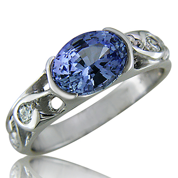 Style: LRO82.R536 ~ A brilliant oval blue sapphire, set in a semi-bezel with diamonds and white gold.