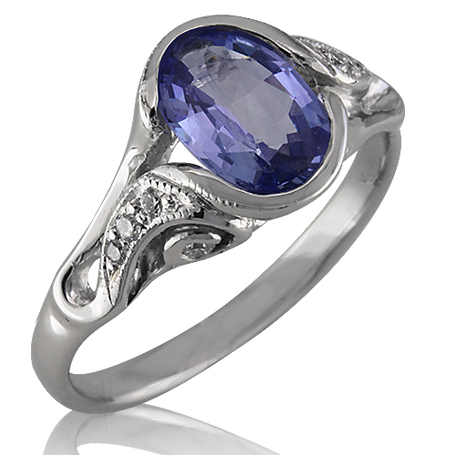 Style:LRO88 ~ This oval blue sapphire is surrounded by white gold and diamonds.