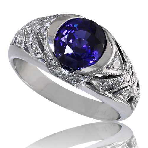 Style:LRR52B  A brillliant blue sapphire set in a filligree ring setting of bead set diamonds with a vintage look.