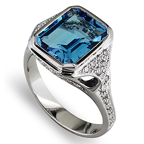 Style:LRS640 ~ An emerald cut blue topaz set in white gold with bead set diamonds.