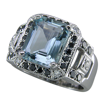 Style:LRS645 ~  An emerald cut aquamarine ring enhanced with black and white diamonds