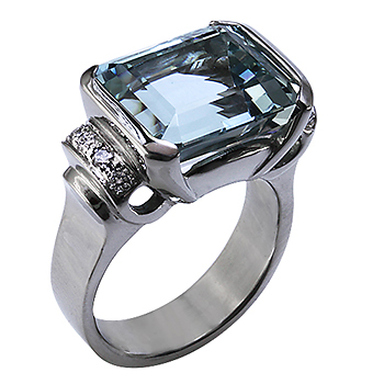 Style:LRS654 ~ This aquamarine makes a statement in this 14k white gold ring, highlighted with diamonds.