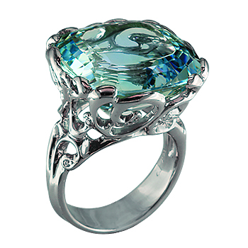 Style: LRM802 ~ A brilliant aquamarine sits inside curls of white gold in this spectacular statement ring