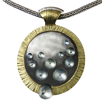 Style:N95 ~  18k yellow gold, sterling silver and moonstones makeup this contemporary pendant.