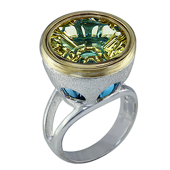 Style:LRR83B.R591 ~ This unique statement ring features  a crazy cut lemon quartz sitting above a blue topaz. Set in sterling silver and 18k yellow gold.