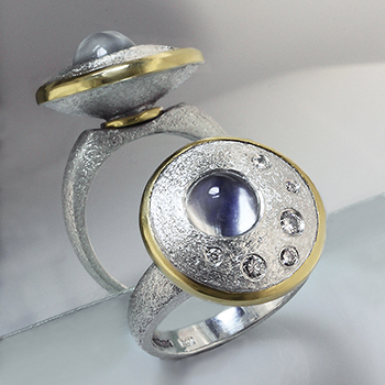 Style:R636 ~ This fantastic ring has a spinning top set with moonstone and diamonds. A Saul Bellow winner!