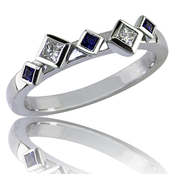 Style:WB245 ~ An Aysmetrical Design of princess cut sapphires and diamonds makes this Wedding Band Unique