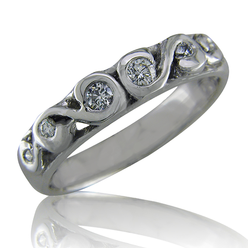 Style: WB124N ~ 6 Diamonds swirled in white gold or platinum.