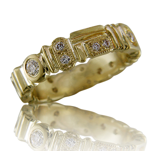 Style:WB205B.R501~ A contemporary 18k yellow gold and diamond eternity band.