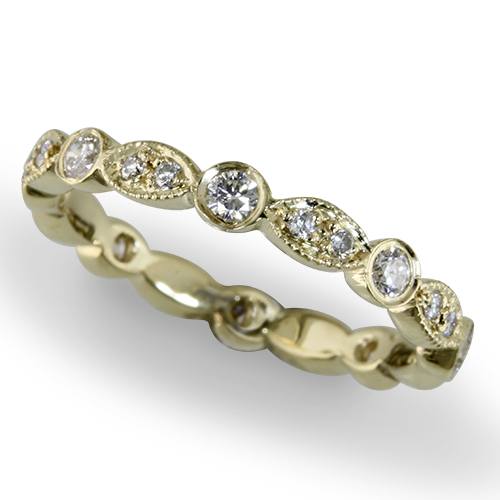 Style:WB237~ A uniquely set eternity band in yellow gold.