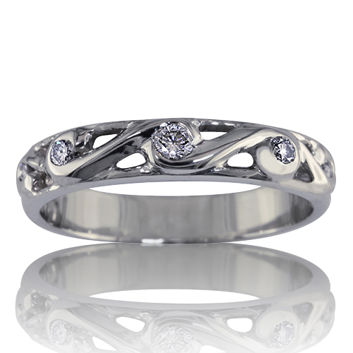 Style:WB239~ Diamonds swirled in gold or platinum makes an elegant wedding band.