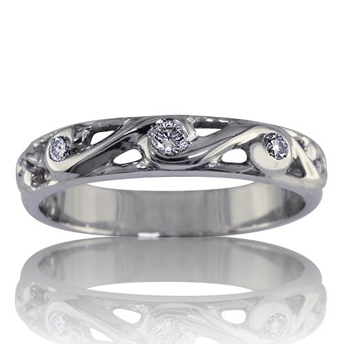 Style:WB239~ Diamonds swirled in gold or platinum makes an elegant wedding band.